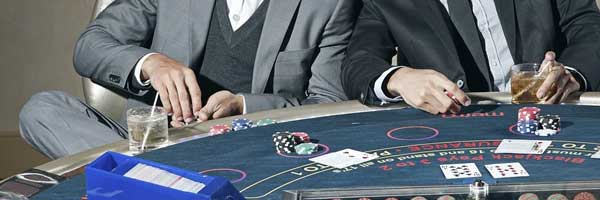 5 New Zealand Land Based Casinos you Need to Stop by During your Next Biking Trip men playing poker - 5 New Zealand Land-Based Casinos you Need to Stop by During your Next Biking Trip